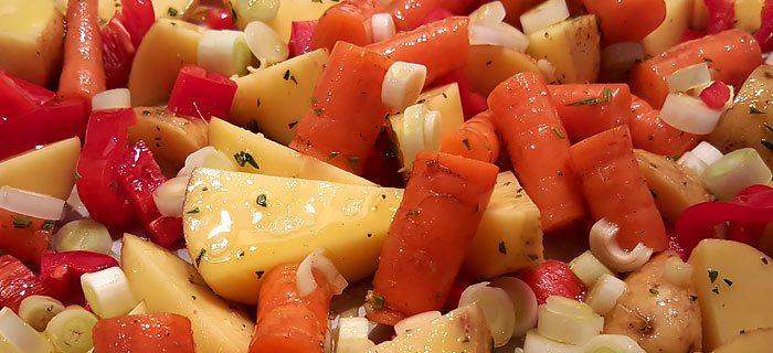 Aardappelwedges met gegrilde groenten en varkenshaas